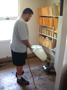 Removal of asbestos containing tile and mastic in my 1914 vinatge office