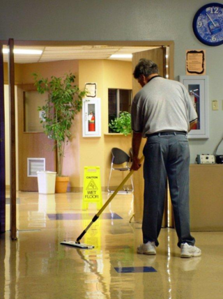 a microfiber mop, and a company executive